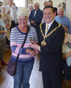 The Mayor of East Staffordshire, Councillor Michael Rodgers presents First Prize for an item of knitting or crochet to Lesley Plant of Ellastone.